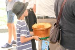 Landres et St. Georges:  A young helper balances his bread bowl and an RDVF flag during a village picnic at the commune of Landres et Saint Georges, France.